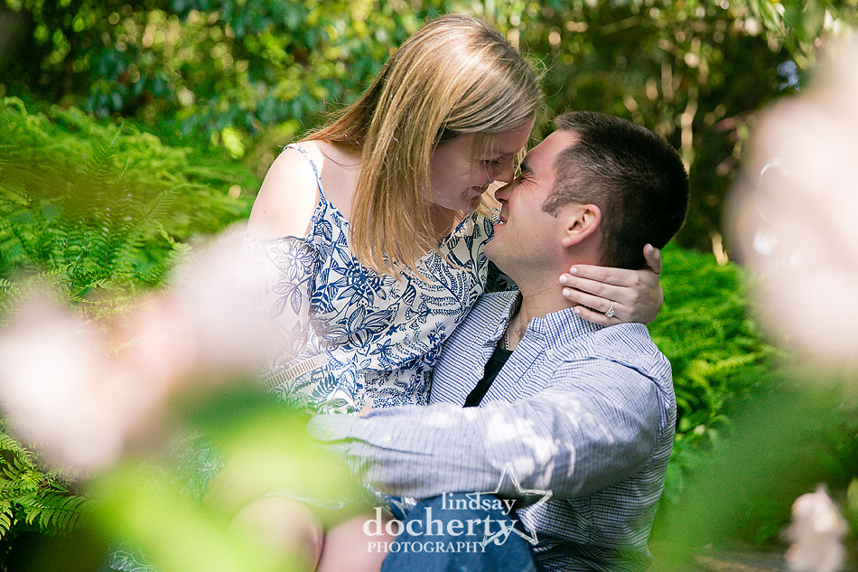 cute nose kiss engagement picture at Longwood Gardens