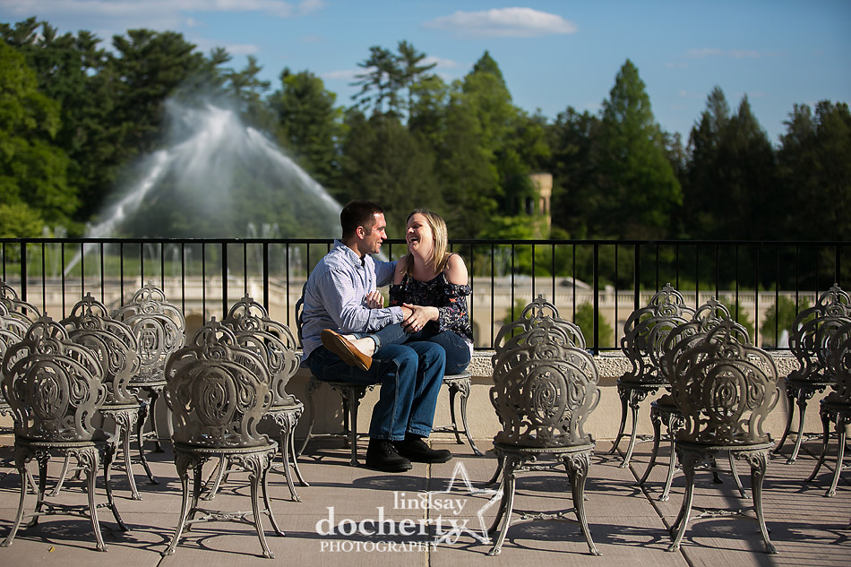 happy couple engagement session in front of new fountains at Longwood Gardens