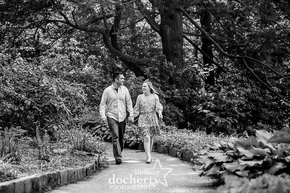 walking along path together at Longwood Gardens engagement session