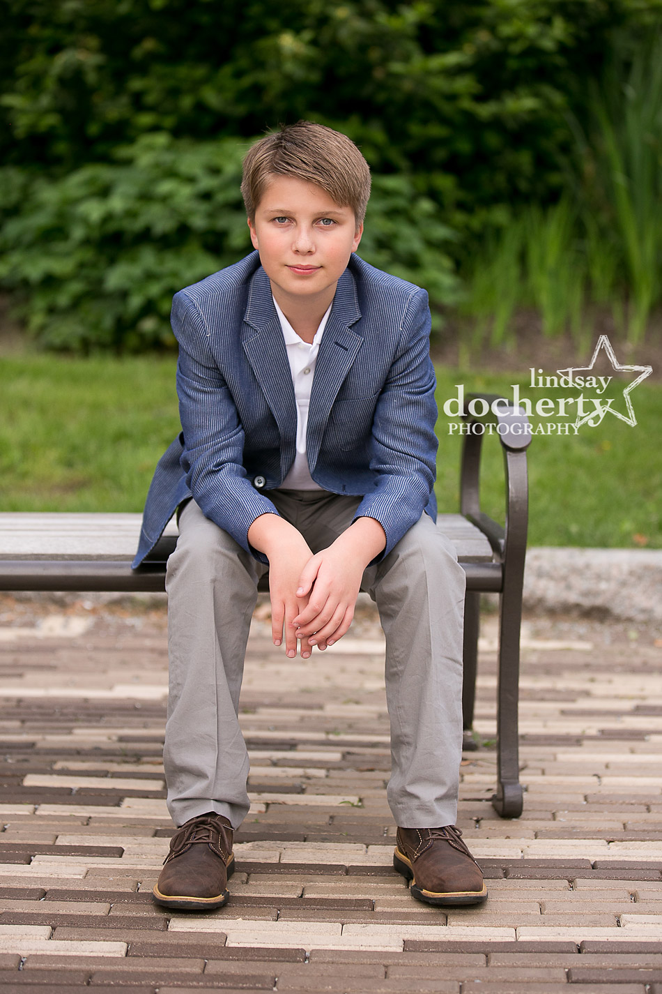 serious tween boy portrait in blazer