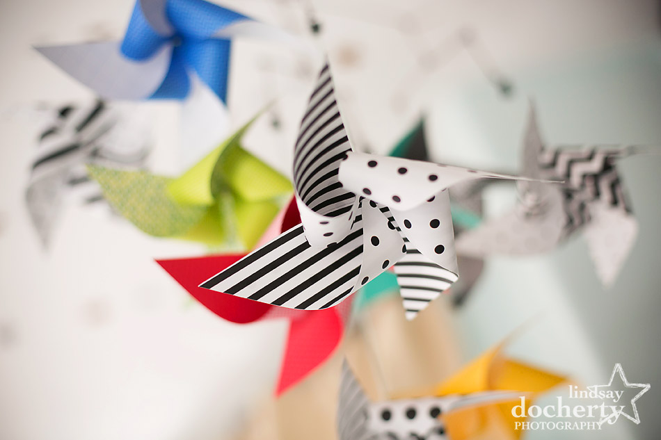 colorful DIY pinwheel mobile for gender neutral nursery