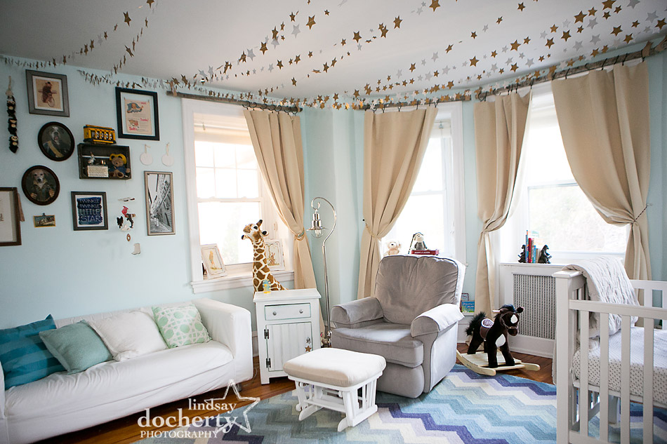 baby's light blue gender neutral nursery with stars on ceiling