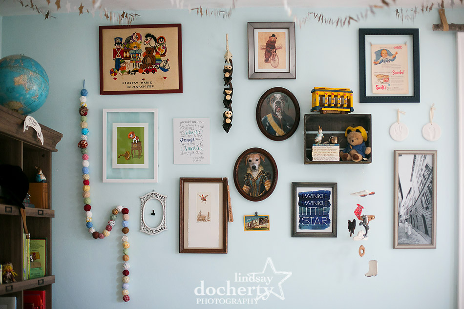 whimsical gallery wall in gender neutral baby nursery