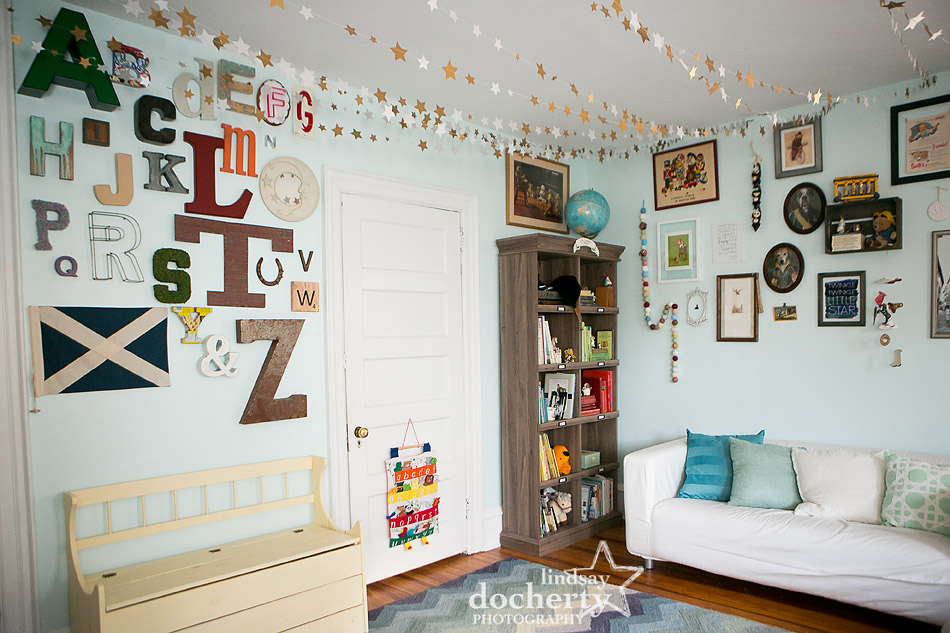 whimsical light blue nursery with stars and alphabet wall