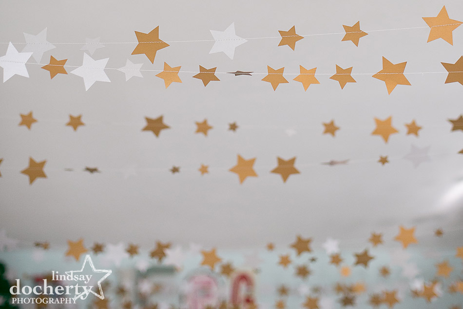 yards of paper star garlands across babys gender neutral nursery
