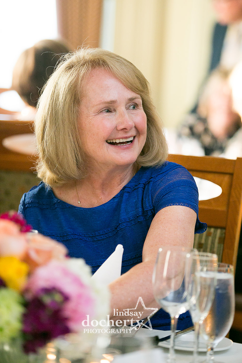 beautiful happy mother of the bride at wedding