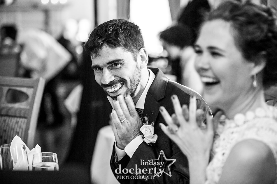 black and white picture of couple during wedding speech