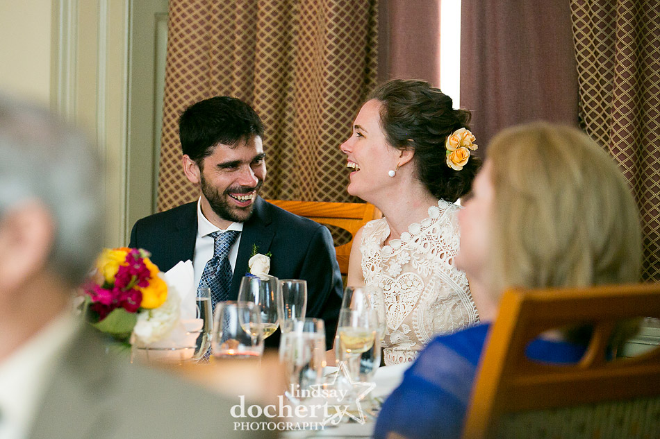 bride and groom laughing during wedding speeches at Davios Steakhouse