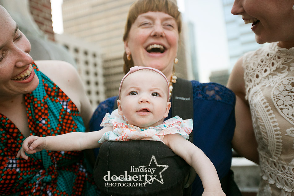 cute baby at wedding with friends of bride