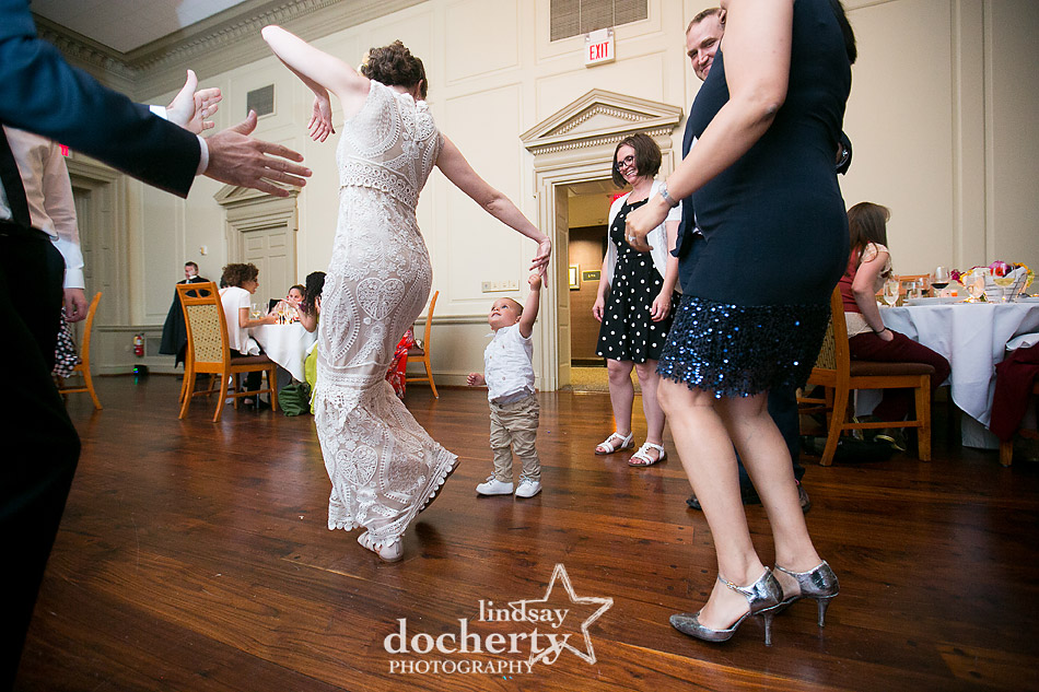dancing with toddler boy at wedding reception
