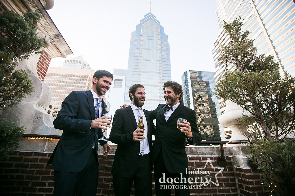 gromsmen laughing together on top of roofdeck at Davios steakhouse