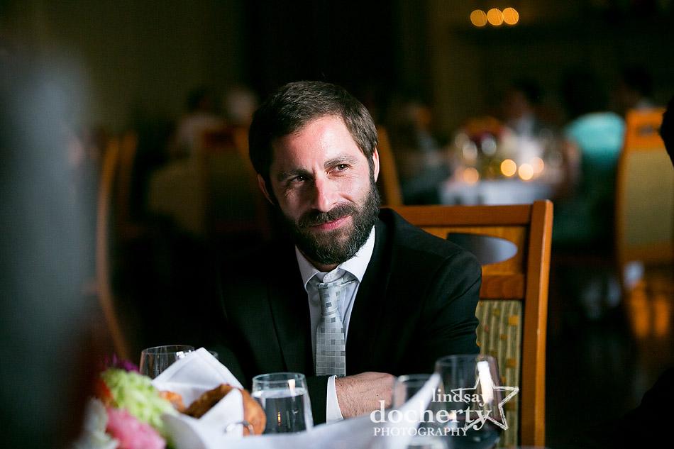 handsome groom at wedding reception