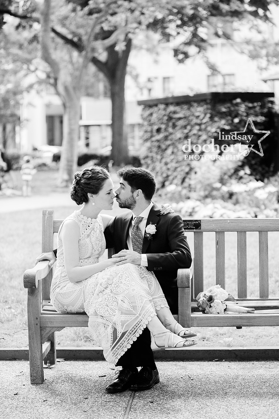 sweet kiss on the nose in Rittenhouse Square on wedding day