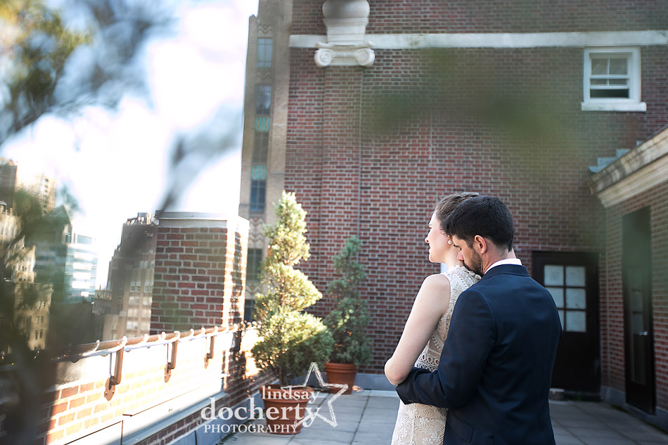 sweet moment between bride and groom at Davios steakhouse roofdeck