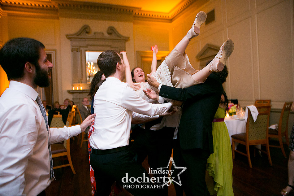 throwing bride in the air during wedding reception