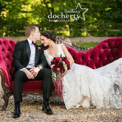 bride and grrom on velvet sofa at Audubon Center wedding