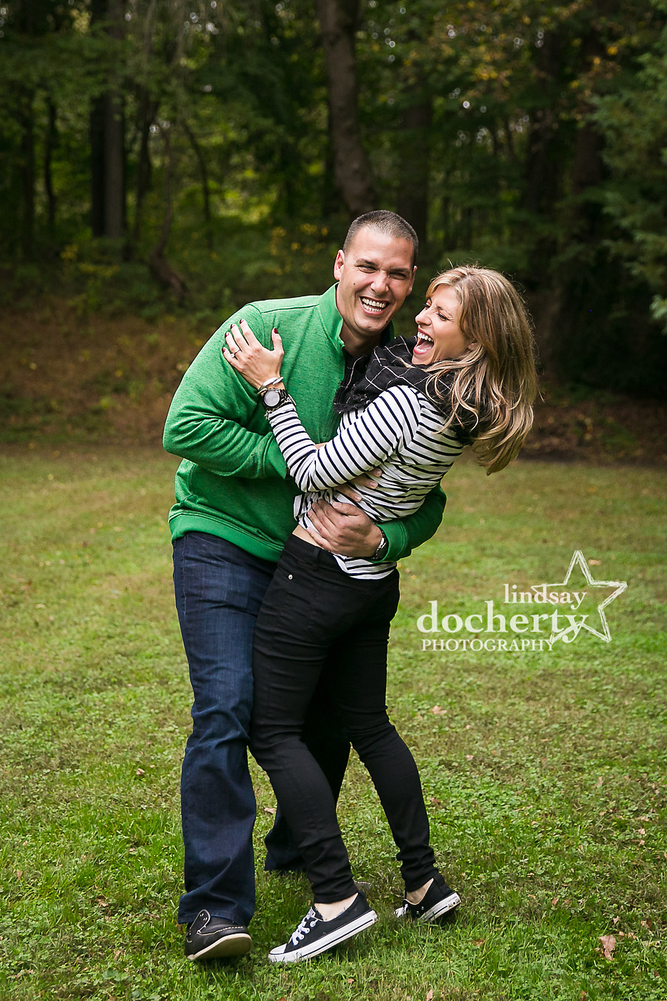 laughing couple at engagement session at Ridley Creek State Park in Media