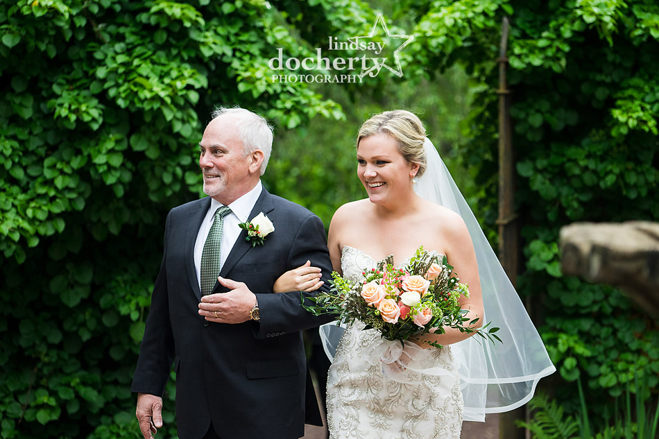 beautiful bride walking down the aisle with father