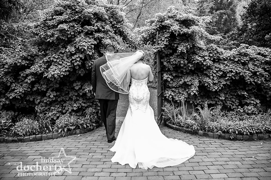 bride and groom walking out gates of Holly Hedge Estate