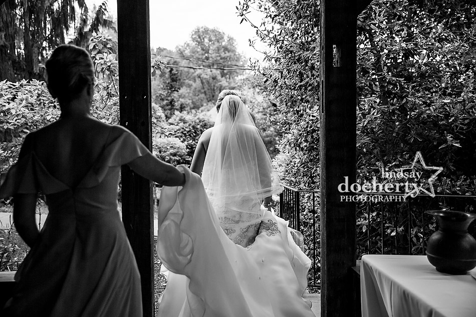 bride and sister on the way to outdoor wedding ceremony at Holly Hedge Estate
