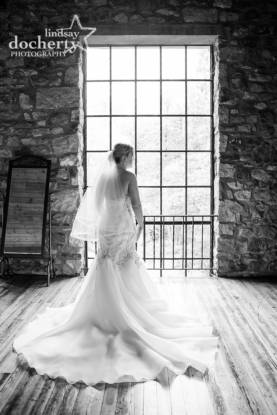 bride at window at Holly Hedge Estate on wedding day