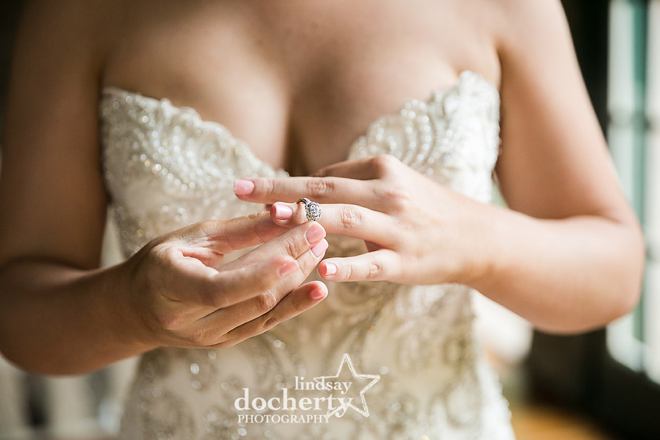 bride putting on equipment ring before wedding ceremony at Holly Hedge Estate