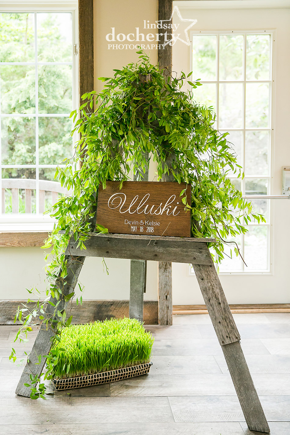 family signage with garland on easel