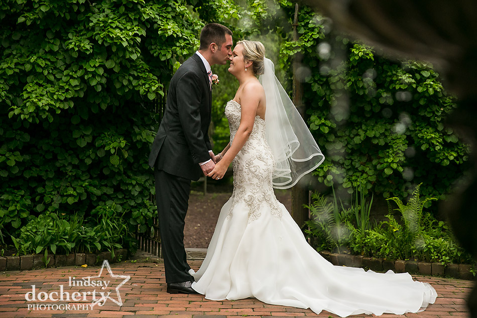 groom kissing bride on nose at Holly Hedge Estate