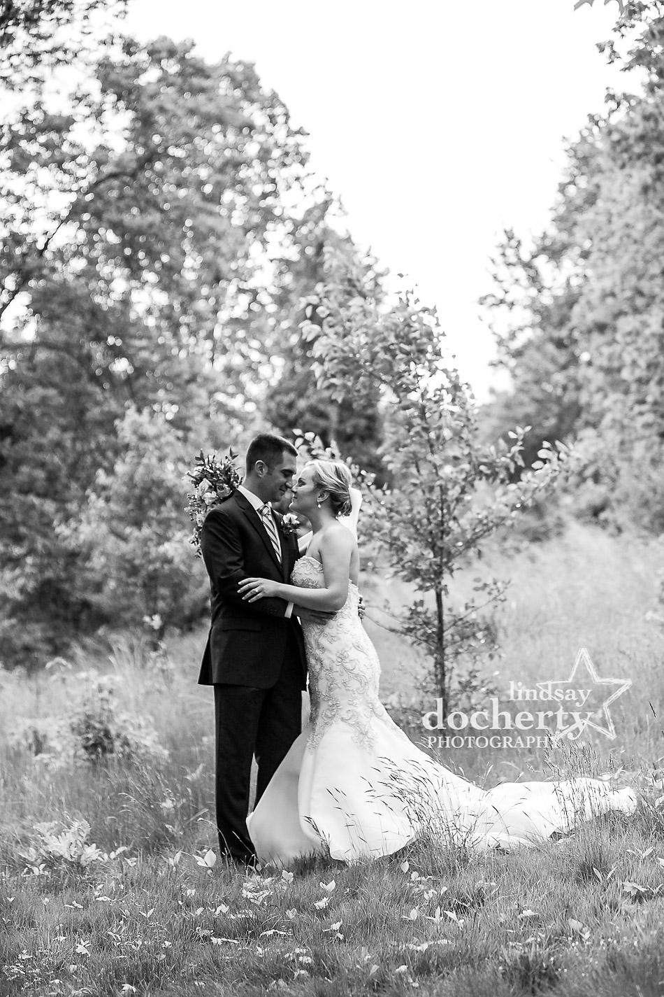 lovely weding portrait of bride and groom in glen behind Holly Hedge Estate