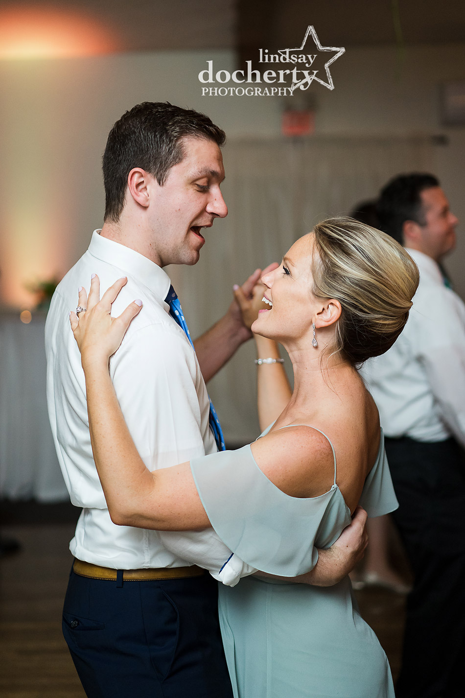 maid of honor and husband dancing during reception at Holly Hedge Estate