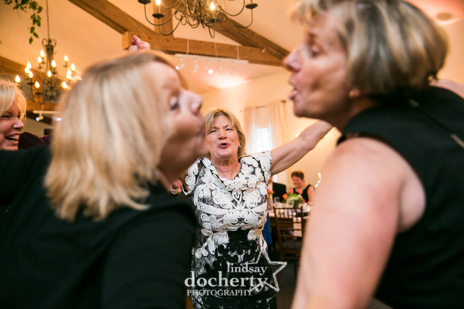 mother of bride dancing with friends at daughters wedding reception at Holly Hedge Estate