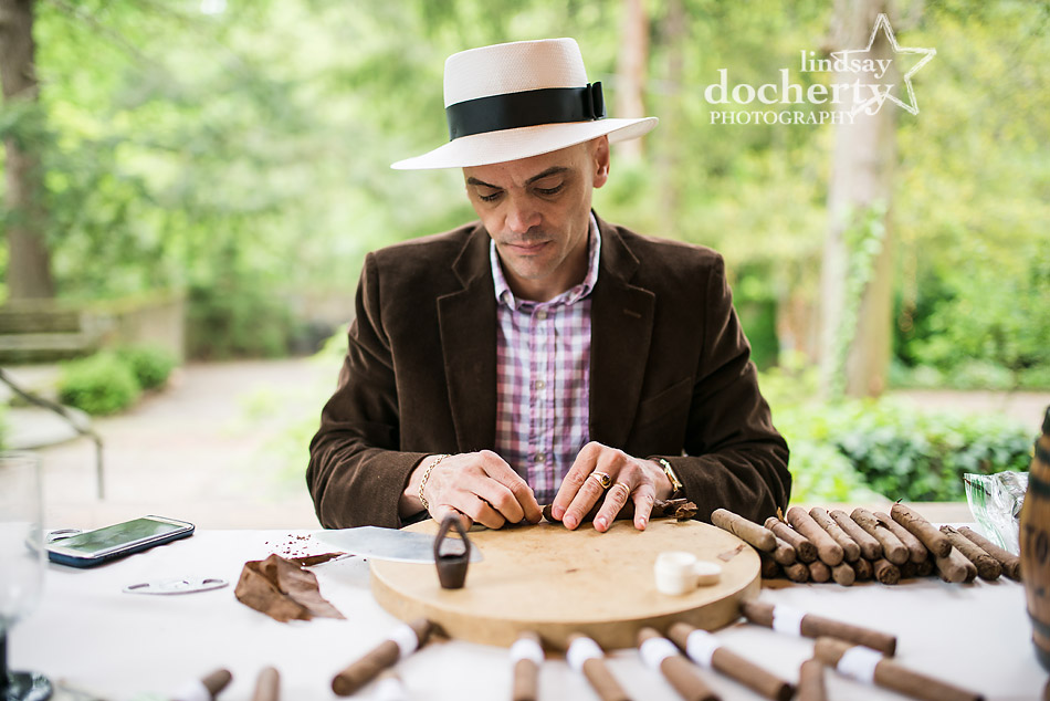 professional cigar roller at cocktail hour at Holly Hedge Estate