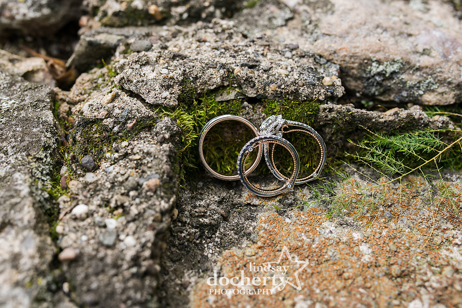 Verragio wedding and engagement rings against old stone and moss
