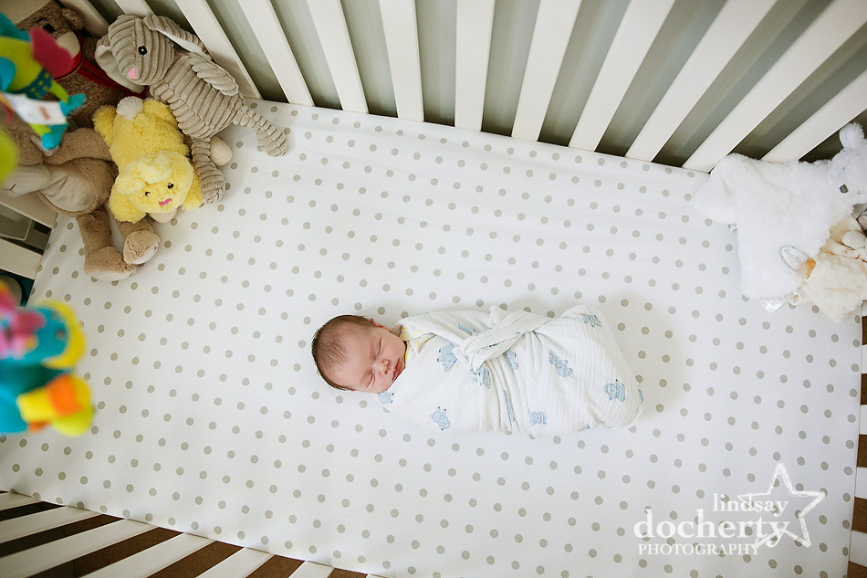 tiny newborn girl in crib