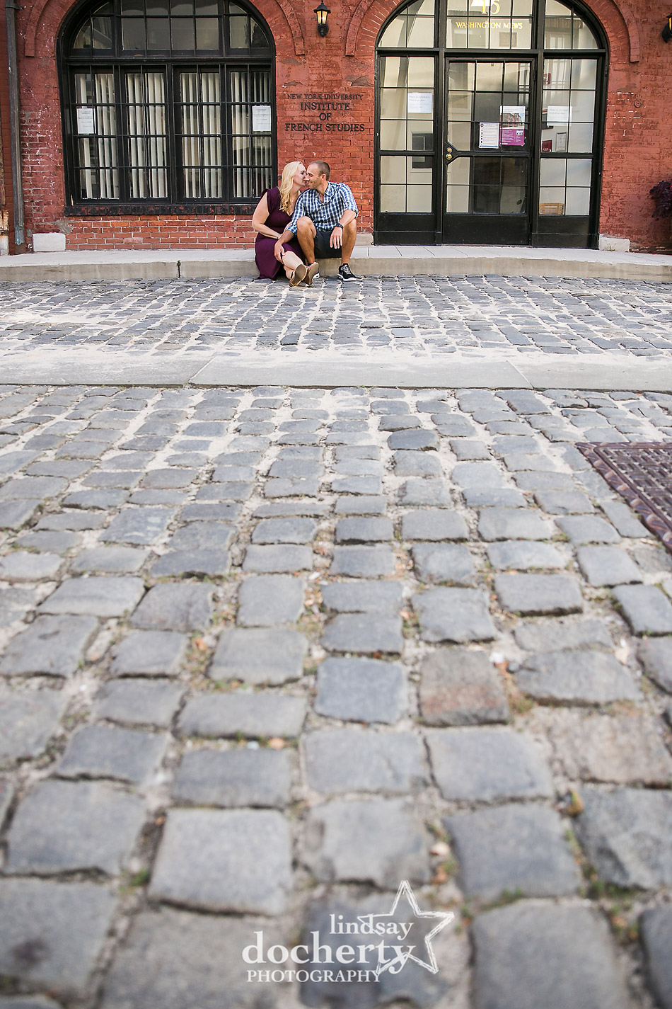 sweet couple picture on cobblestone street in West Village