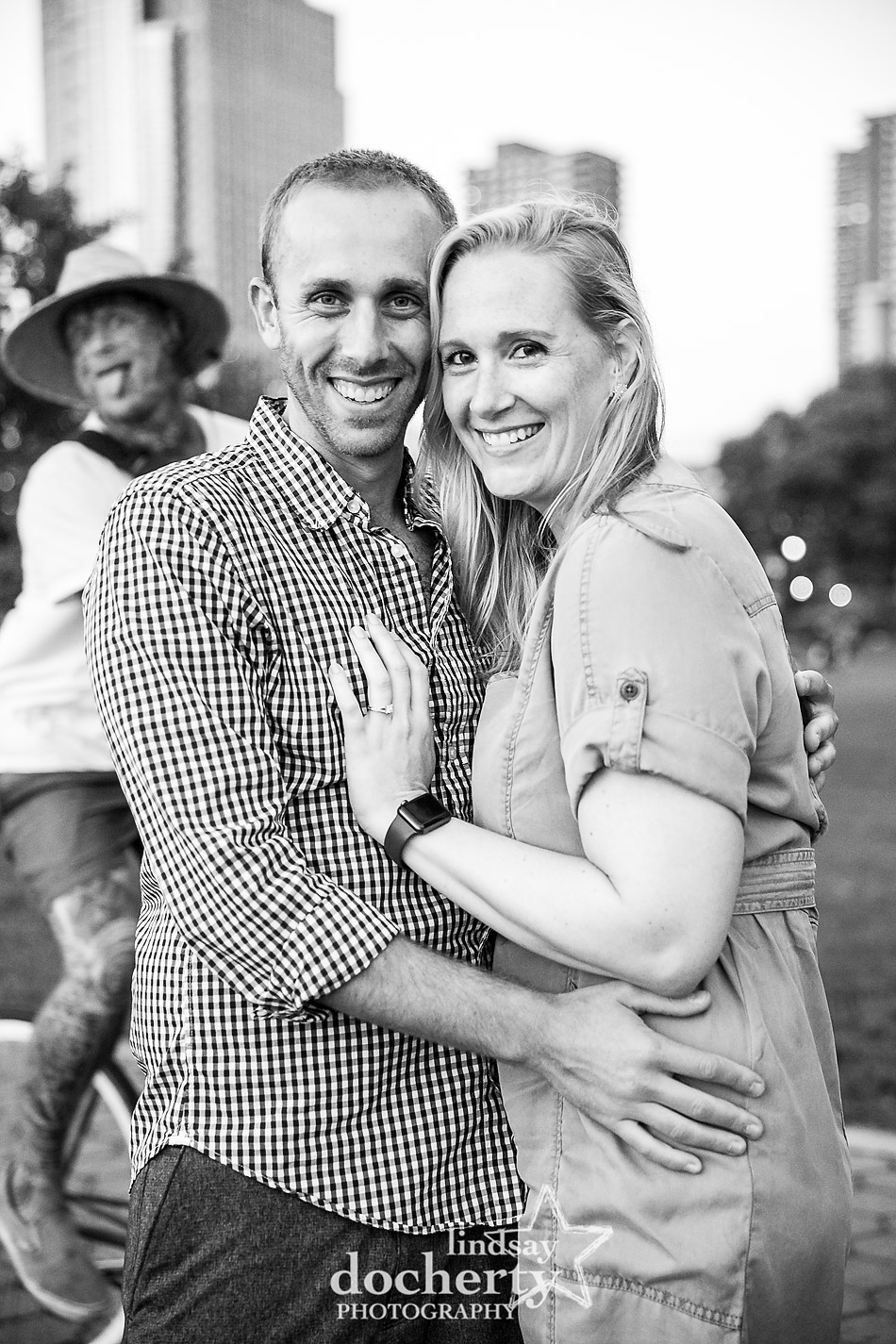 funny photobomber behind couples engagement session picture at Rockefeller Park