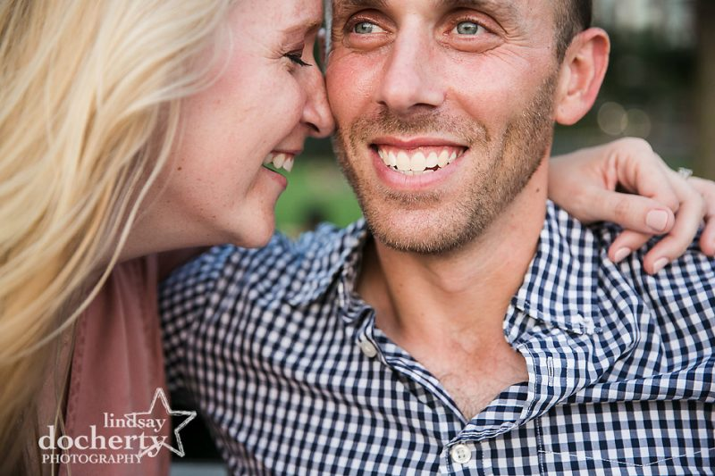 laughing together at NYC engagement session at Rockefeller Park