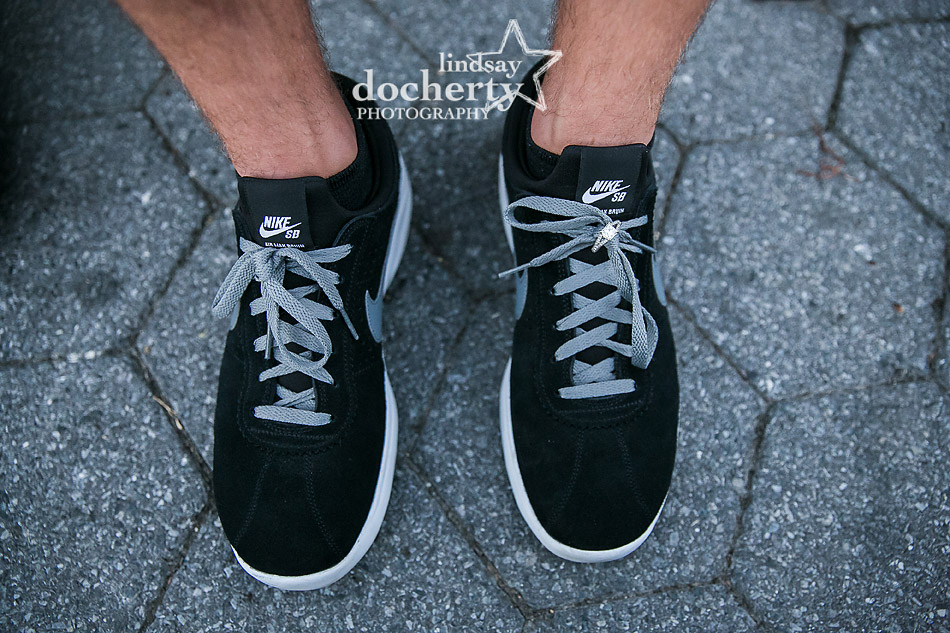 diamond engagement ring on black Nike sneakers