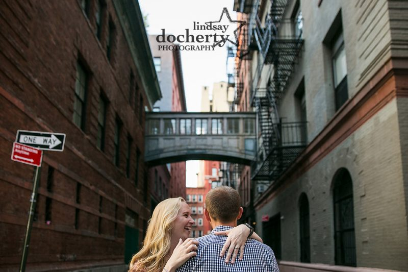 sweet engagement picture with NYC skybridge in background