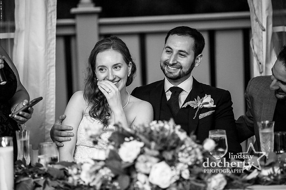 bride and groom during toasts at Morris Arboretum wedding