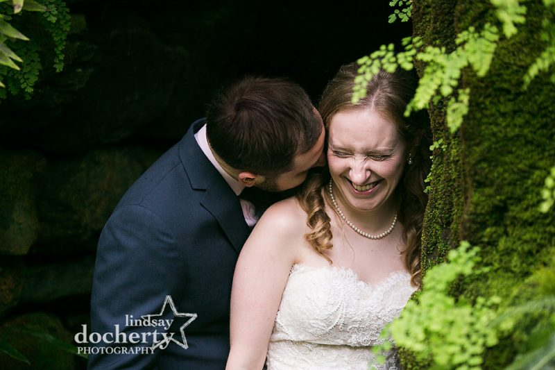 bride and groom in fernery at Morris Arboretum on wedding day