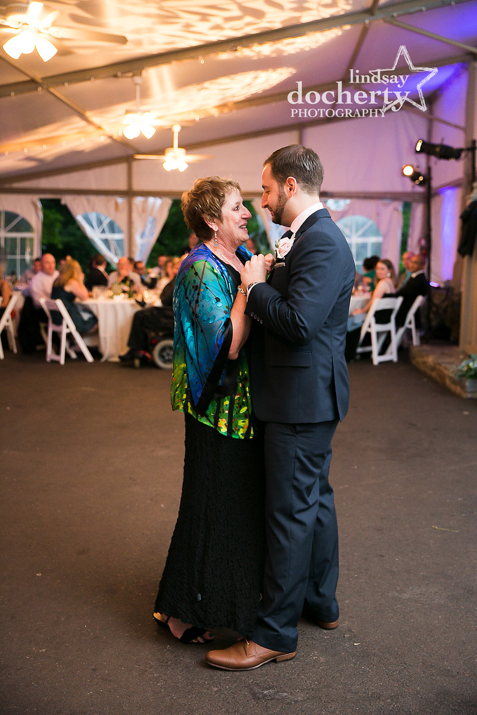 groom dancing with mother at reception at Morris Arboretum