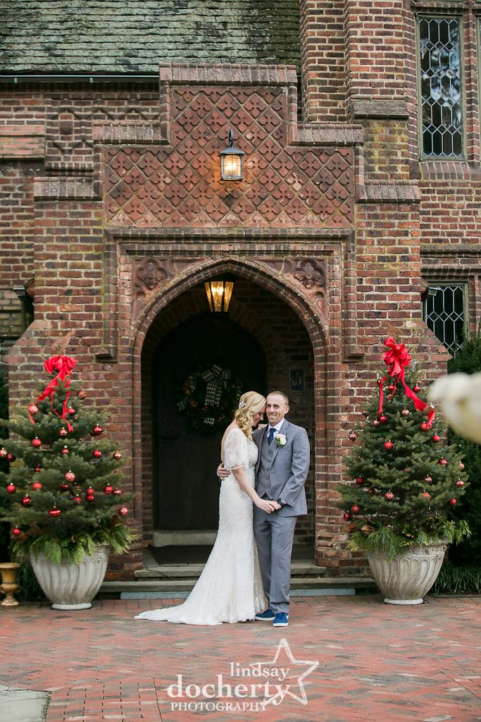 bride and groom cuddling together outside of Aldie Mansion on winter wedding day