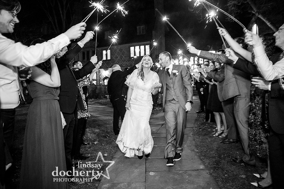 bride and groom going through sparkler sendoff at Aldie Mansion