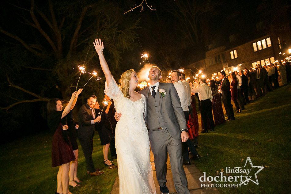 bride and groom going through sparklers outside of Aldie Mansion wedding