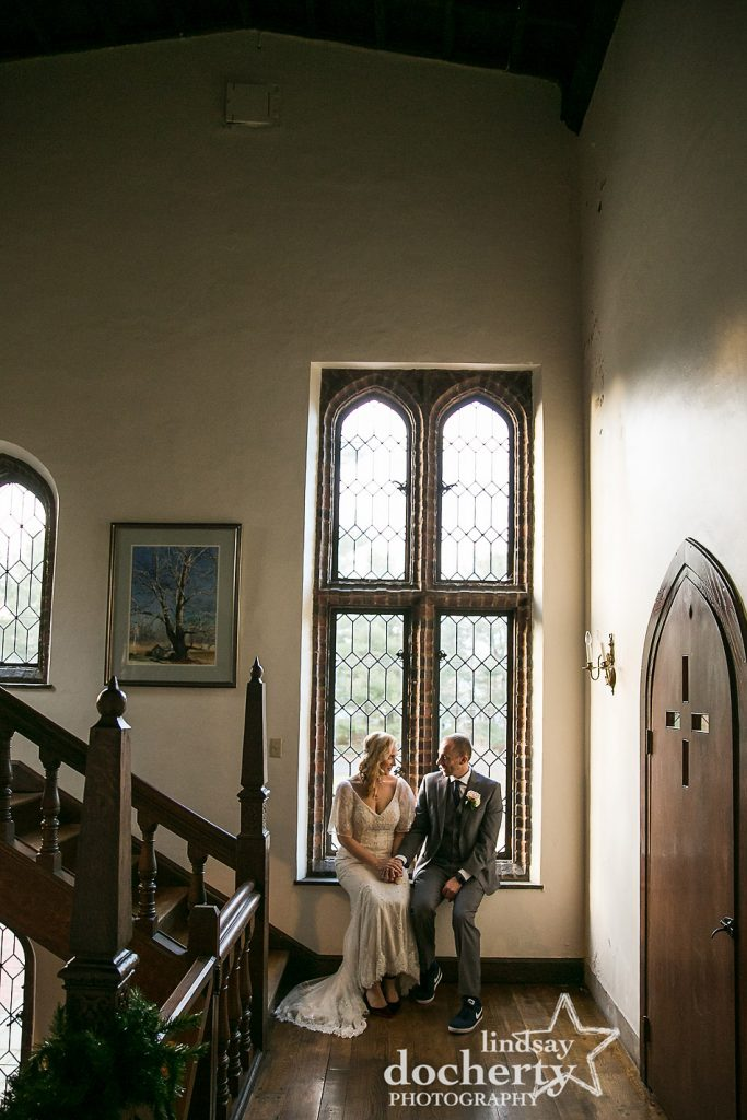 bride and groom in front of beautiful window at Aldie Mansion