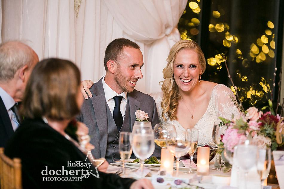 bride and groom listening to speeches at wedding at Aldie Mansion