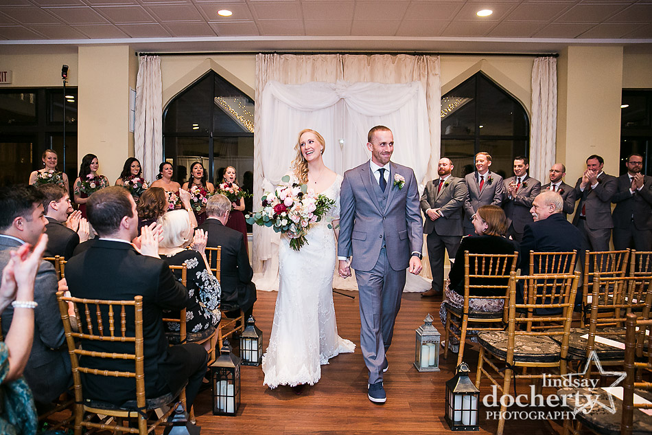 bride and groom recessional after ceremony at Aldie Mansion
