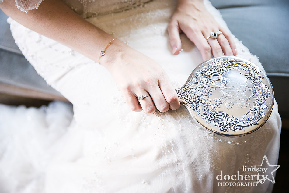 bride holding grandmothers vintage mirror