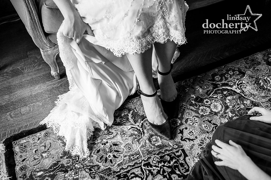 bride showing off closed toe velvet shoes